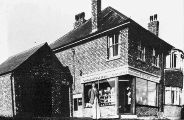 Mr. Tom Clayson outside of his new Post Office opened in 1938