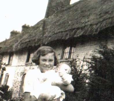A view of the front of the cottages. The young girl is Mrs. Kath Smith, née Harrison, whose family lived in the cottages. Her family was not related to Frank Harrison's family.