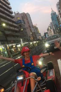 Maricar driving the streets of Tokyo in a kart dressed up as Mario Kart