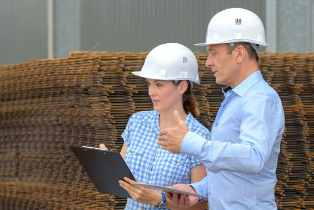 Company managers wearing hard hats