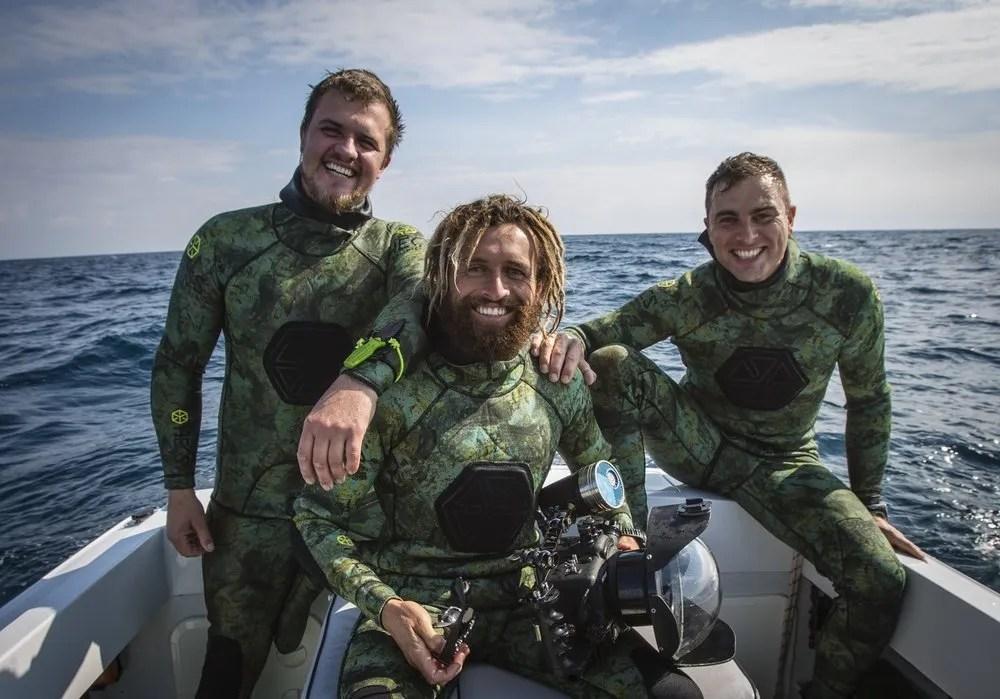 Andre Rerekura (center) Terra Australia. HECS wetsuits