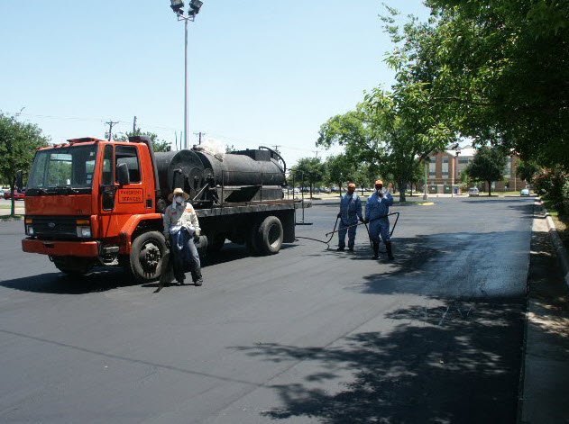 Our crew applying a seal coat on a parking lot.