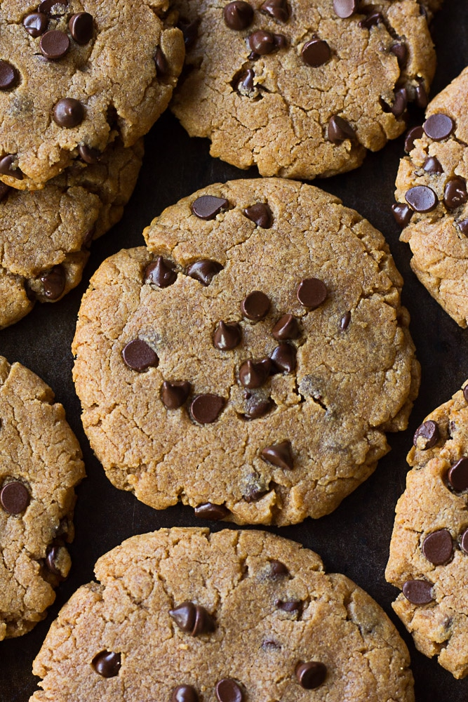Oil Free Peanut Butter Chocolate Chip Cookies on pan crowded together.