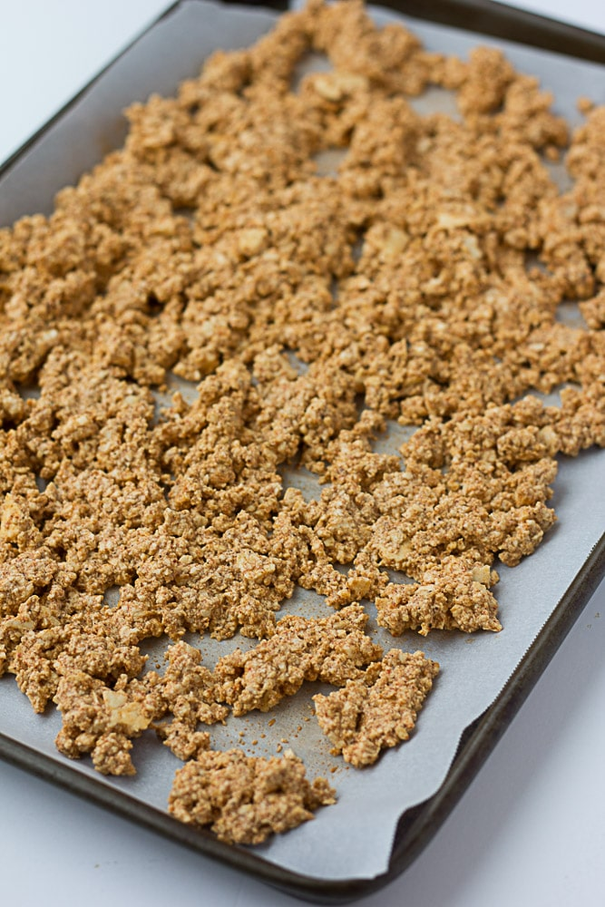 uncooked tofu crumbles on a pan.