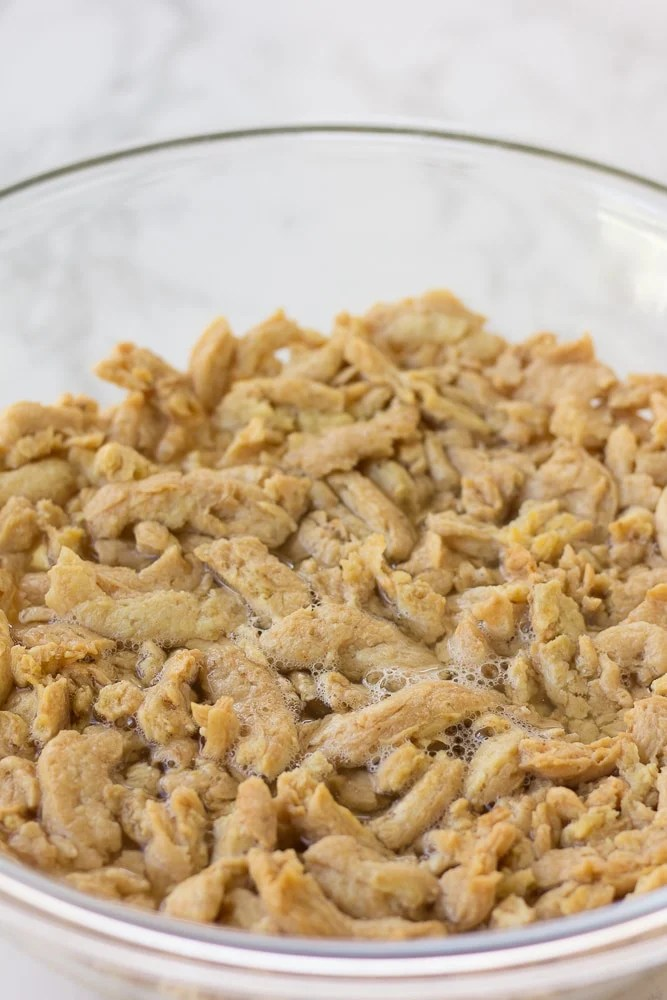soy curls being soaked in a bowl