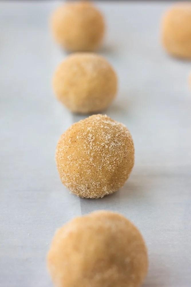 cookie dough balls rolled in cinnamon sugar for vegan snickerdoodles