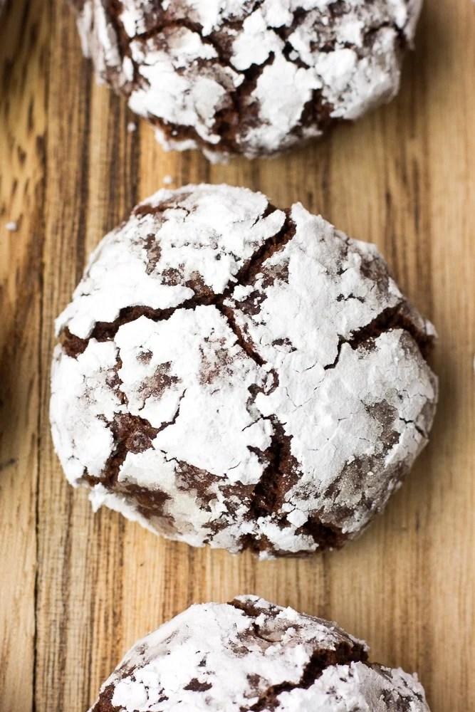 vegan chocolate crinkle cookies on wood board
