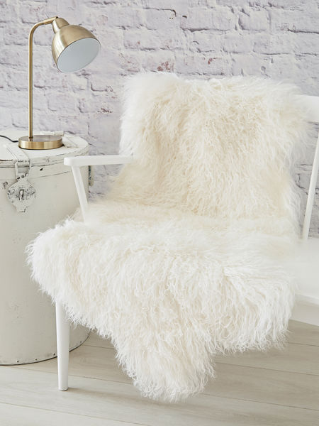 long white sofa table leather sectional with ottoman tibetan sheepskin rug | nordic house