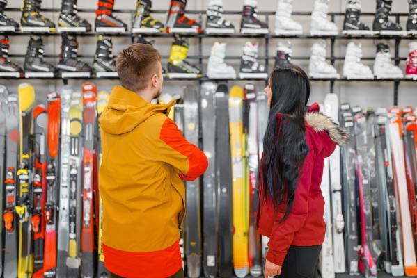 couple-choosing-skiing-or-snowboarding-equipment.jpg