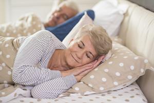 Woman and her husband sleeping comfortably