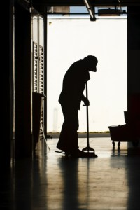 Man mopping factory floor