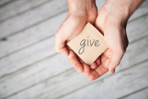 Two hands offering to give, donate or charity