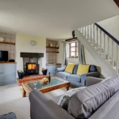 Cosy Living Room With Log Burner Furniture Configuration In Lyng Cottages Norfolk Sitting Comfortable Seating And Wood Perfect To Warm Your Toes On