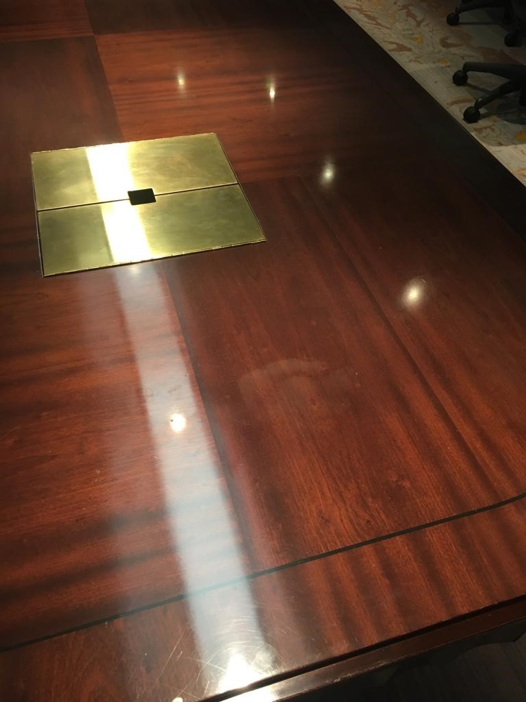 scratched boardroom table