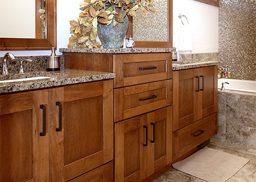 Showplace bath vanities in various medium tones and finishes