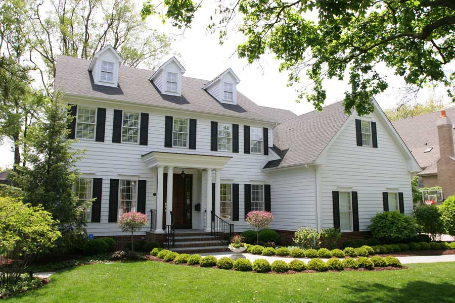 White Colonial House Exterior Renovations  Normandy