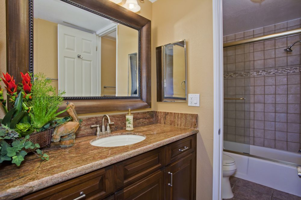 E101 warm toned bathroom vanity with granite counter tops