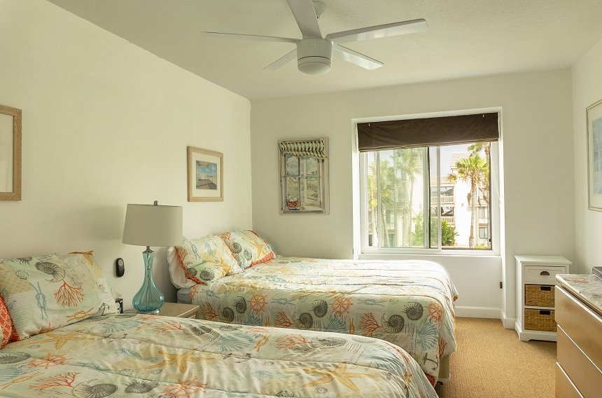 d305 guest bedroom with 2 beds and large window