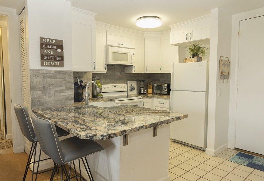 Unit D305 white cabinets and kitchen appliances