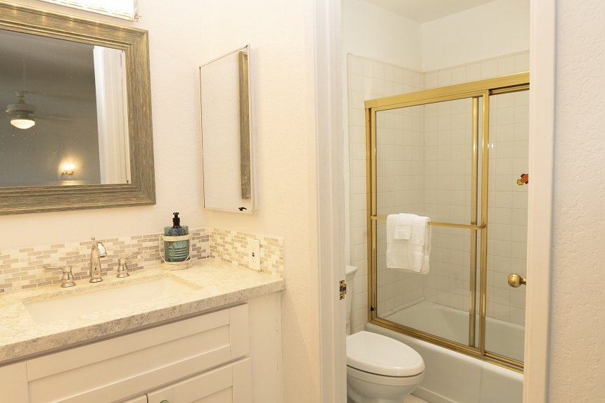 Unit D-305 master bathroom with tub shower combo
