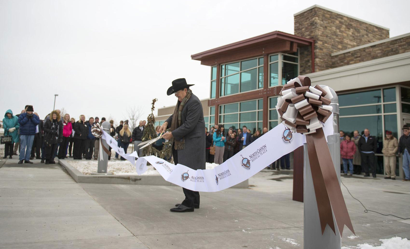 Tim Powers, chief executive officer, cuts the ribbon during the dedication for a new medical plaza in December 2016 at North Canyon Medical Center in Gooding. DREW NASH, TIMES-NEWS FILE PHOTO