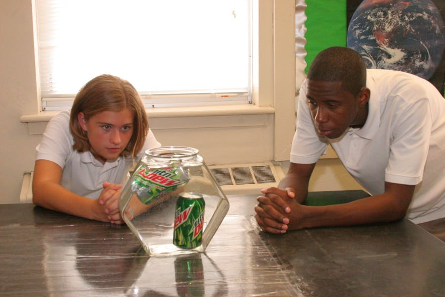 Middle-schoolers Cassidy Ward and DeAndre Foote consider soft drink options.