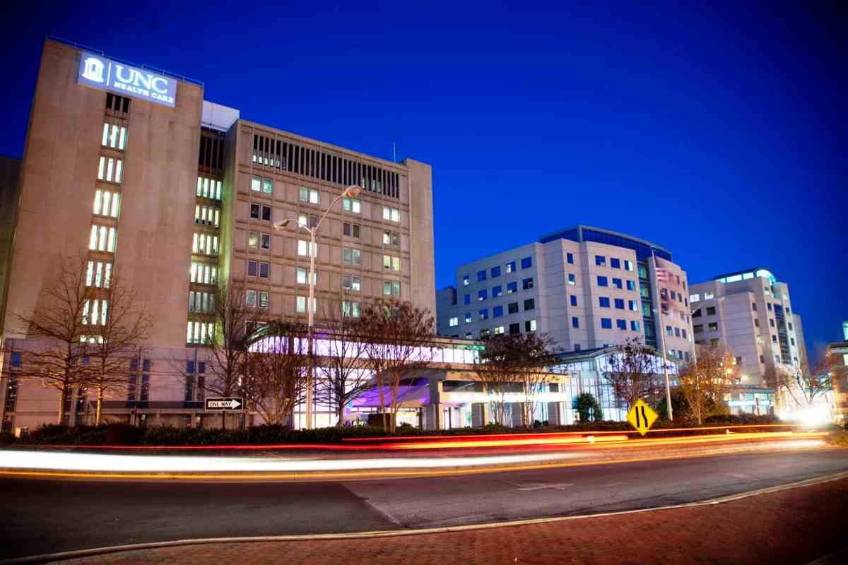 photo shows UNC Hospital at night/ The hospital was recently the subject of a critical story in the NY Times that examined the pediatric heart surgery program.