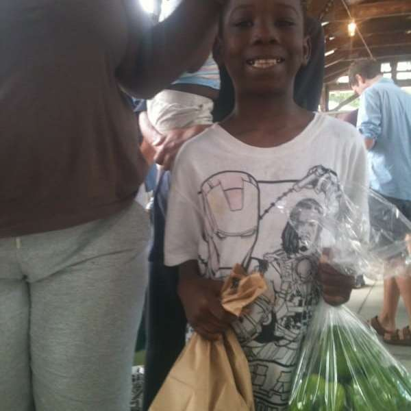 Antonio Jones shops with his mom at the Carrboro Farmers Market