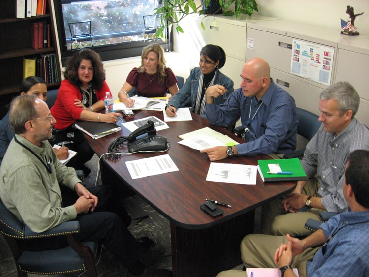 The epidemiological investigation team of the state Communicable Disease Branch holds their daily conference call with officials from affected counties.