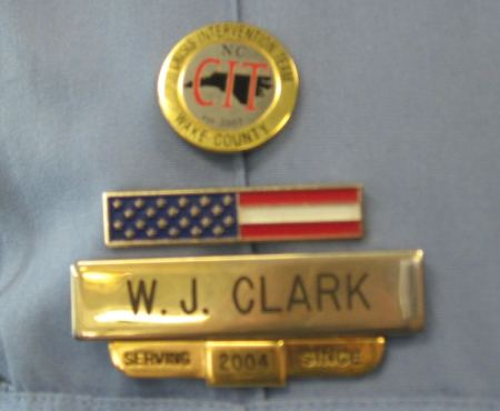 Raleigh PD Sr. Officer Wendy Clark's badge and CIT pin.