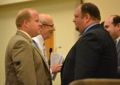 NC Hospital Association lobbyist Cody Hand talks with Sen. Ralph Hise (R-Spruce Pine), co-chair of the Senate Health and Human Services Committee. Photo credit: Jasmin Singh