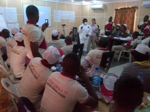 Dr. Jennifer MacFarquhar works with public health workers in Nigeria teaching them about infection control practices. Photo courtesy Jennifer MacFarquhar