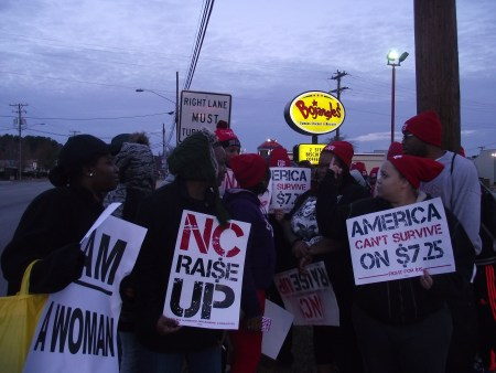 Employees of the Bojangles gathered in front of their workplace to protest for higher wages and collective bargaining rights. Pictured from left, Sherice Moss, Sherri Lilly, Nyrisha Satterwhite, Shekevia Bernett, , Cassie Parker and Brian Hayes.