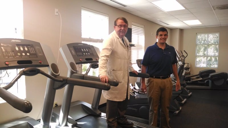 E. Brooks Wilkins and his son William Wilkins in their Raleigh wellness center. William Wilkins is the manager of the wellness program.