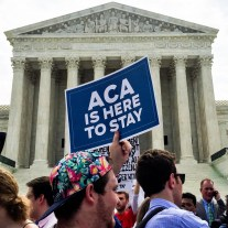 A proponent of the Affordable Care Act celebrates in front of the US Supreme Court on Thursday morning. Photo credit: Virginia Pickering, flickr creative commons