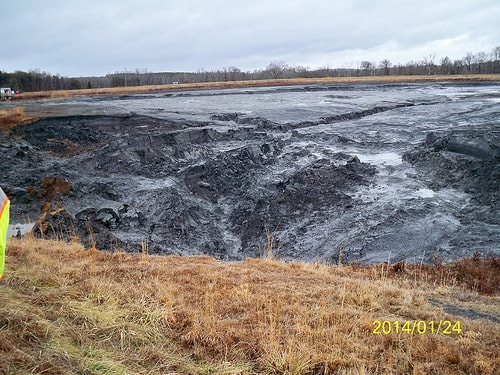 Wet coal ash left over from last February's spill into the Dan River. Photo courtesy N.C. Department of Environment and Natural Resources. photo shows a large mass of grey, mushy ash