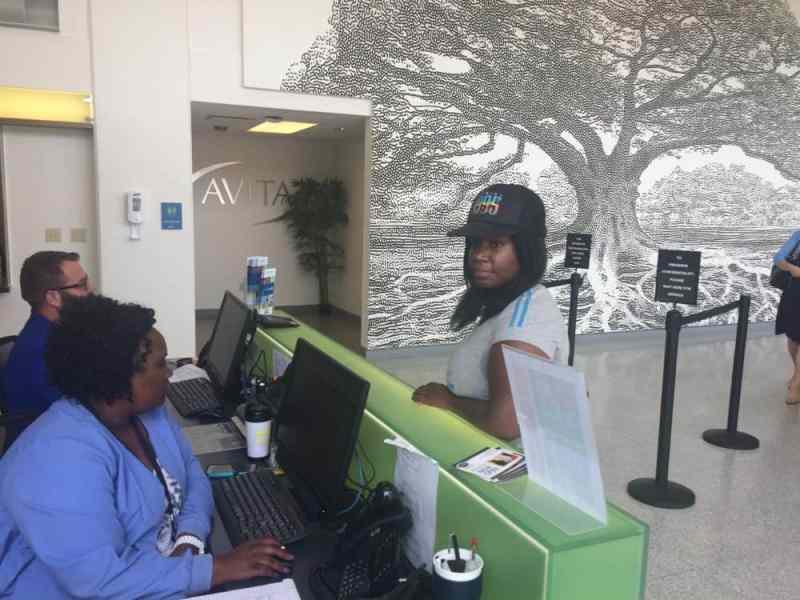 Aretha Frison (right) at Crescent Care.