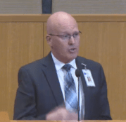 Mecklenburg County Health Dept. Medical Director Stephen Keener appraises county commissioners about the status of the Whitewater Center.