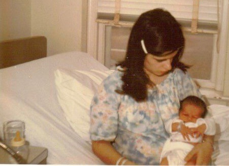 3: After a pregnancy at Camp Lejeune, Mike Partain's mother holds him the day he was born at Camp Lejeune Naval Hospital. At bottom left is a bottle of formula mixed with Camp Lejeune water, which Partain was exposed to in the womb and after his birth. He is among the formerCamp Lejeune residents diagnosed with highly rare male breast cancer. Photo courtesy of Mike Partain.