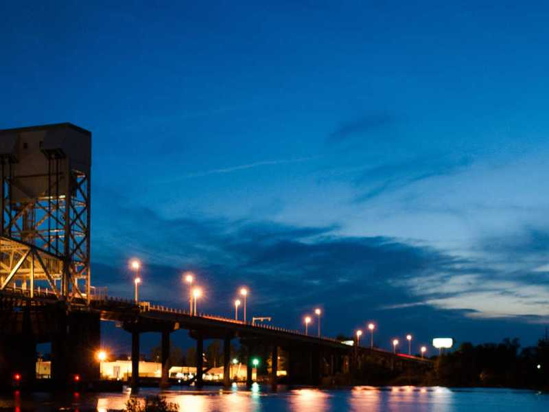 cape fear memorial bridge at sunset with a pretty sky in the background