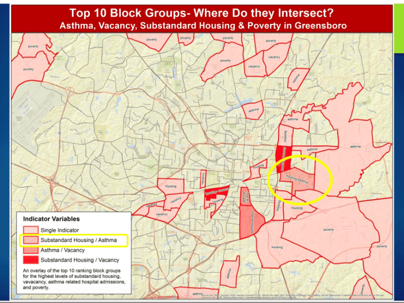 Shows a map with multiple areas of eastern and northern Greensboro colored in red. One area, right near the center of town, is circled in yellow.