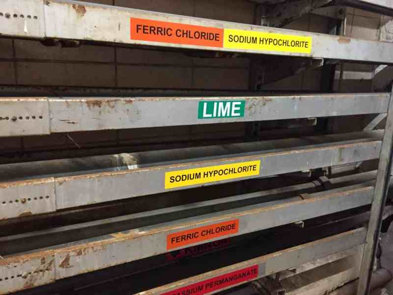Shows pipes labeled with chemical names, such as lime, ferric chloride, etc, in a water plant