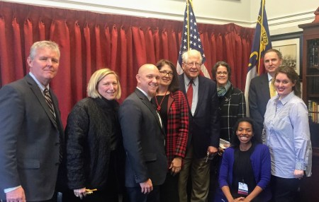 shows a group of advocates with a congressional representative.
