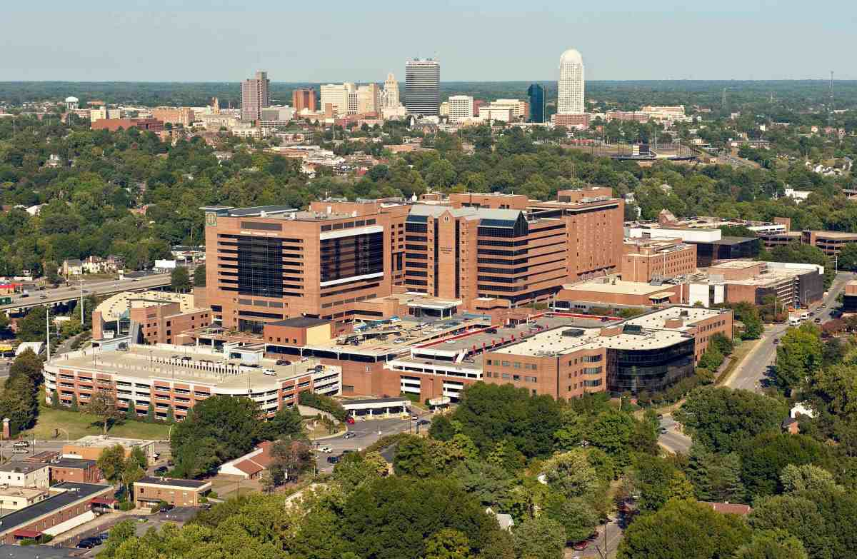 aerial photo of Wake Forest Baptist Medical Center with winston-Salem in the background. Researchers at the hospital created a device that may eventually be used as treatment for liver cancer.