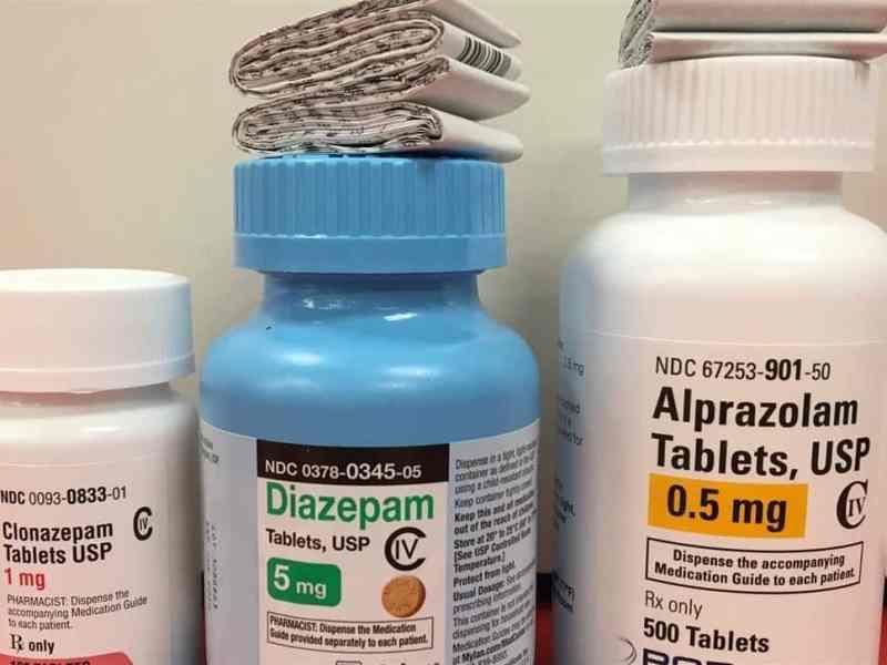 shows three pill bottles for diazepam, clonazepam and alprazolam