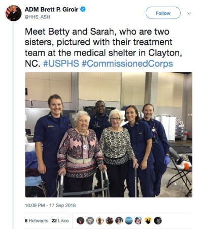 Tweet reads: Meet Betty and Sarah, who are two sisters, pictured with their treatment team at the medical shelter in Clayton, NC