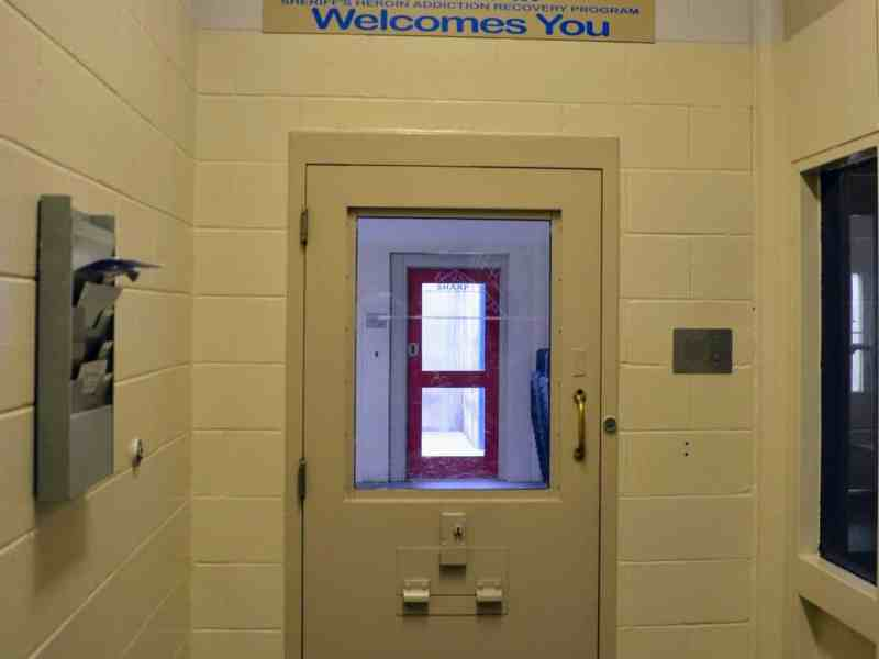 Door to a unit inside a jail. Jail suicides and overdoses are on the rise across the state. The counties may not have enough resources to fight COVID-19.