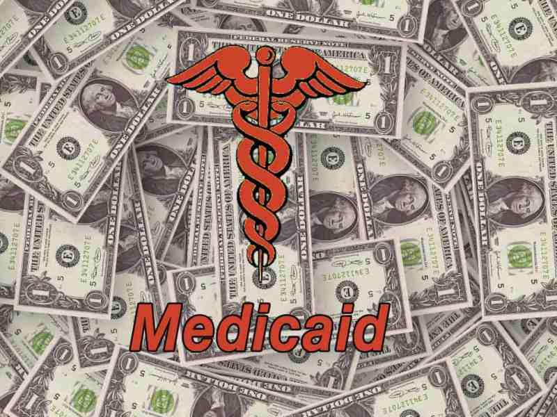 Image of money with a caduceus superimposed on the bills. We're using this image to denote Medicaid managed care.