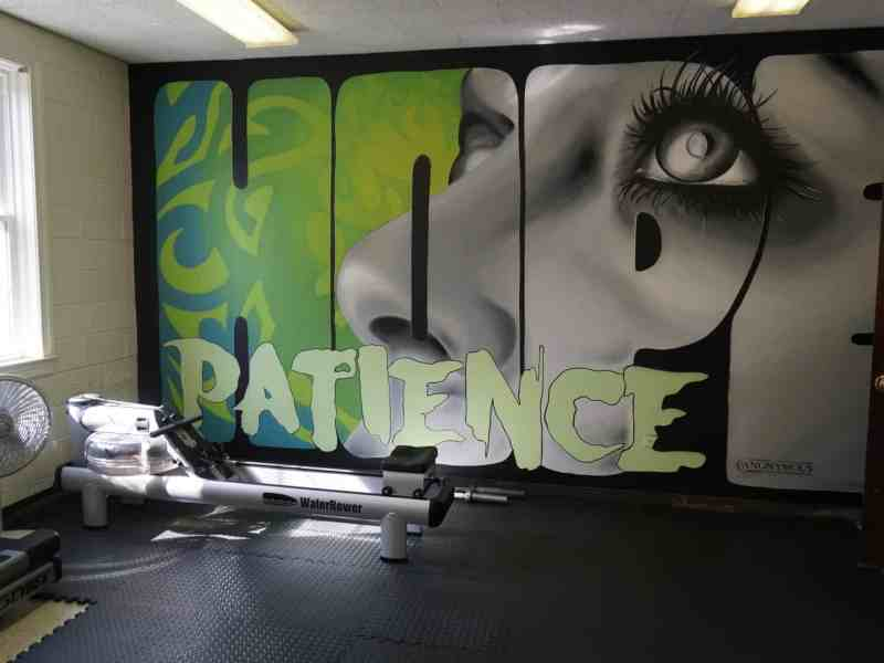 A mural reading 'hope' and 'patience' in a gym at Emerald School of Excellence, the state's first recovery high school