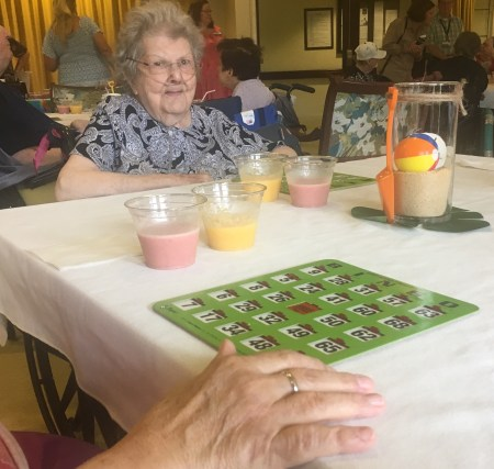 residents of nursing homes receiving grants from penalty payments enjoy a game of bingo.